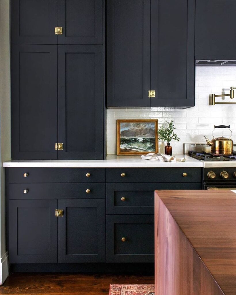 Two-tone kitchen in black and white with a wood color pop.