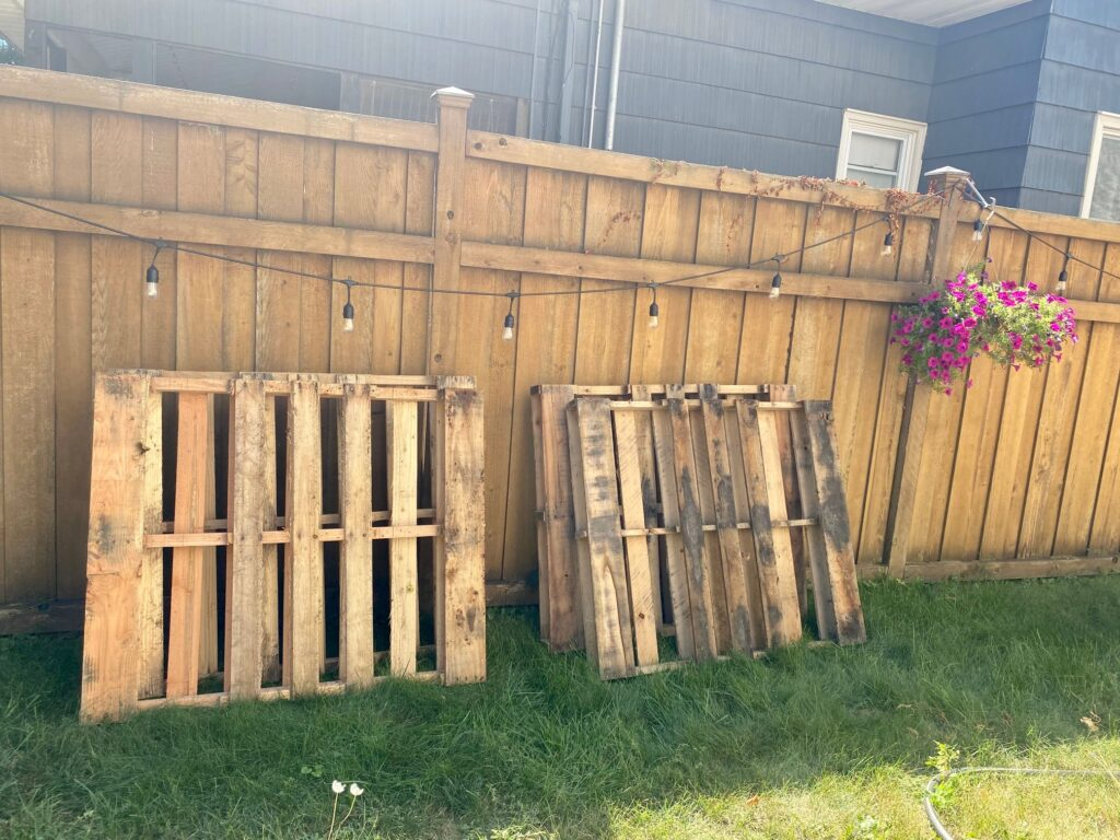 pallets leaning against a fence